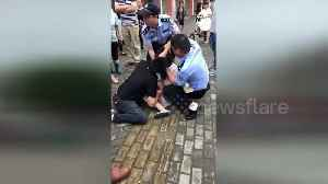 News video: Police teargas woman who bit boyfriend's tongue and refused to let go