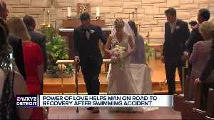 News video: Paralyzed man walks down the aisle on wedding day after being told he may never walk again