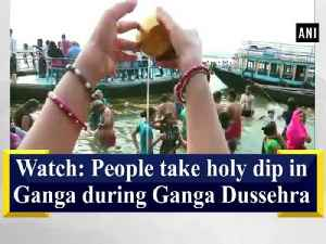 News video: Watch: People take holy dip in Ganga during Ganga Dussehra