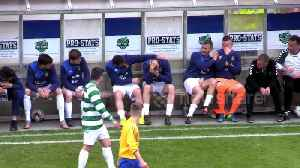 Footballer on bench gets involved after receiving painful ball to head [Video]