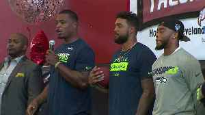 News video: Seahawks Players Surprise High School Athletes with $20K Check for New Equipment