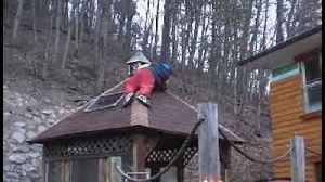News video: Funny Boy Fals While Setting Up The Christmas Lights