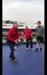 News video: Road-tripping Liverpool fans play catch with replica Champions League trophy on ferry