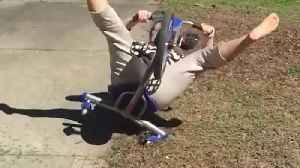 News video: A Woman Slides On a Tricycle and Falls backwards