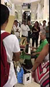 News video: Uplifting moment pensioner leads shoppers in piano sing-along