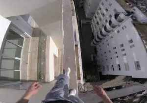 News video: Fearless Dare Devil Performs Balancing Acts on Moroccan Roof Top