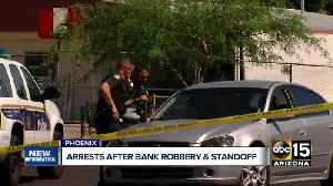 News video: Two bank robbery suspects in custody after hours-long standoff in Phoenix