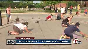 Chalk messages of support written on sidewalks outside Noblesville schools