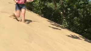 Girl Runs Down Sandy Hill But Then Falls At The End [Video]