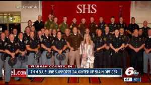 Daughter of slain Indiana trooper graduates surrounded by 39 of her father's 'brothers in blue'