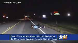 Cars Buzz Around Woman Passed Out In Middle Of Texas Road [Video]