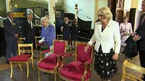 Queen and Duchess of Cornwall watch detection dogs in action