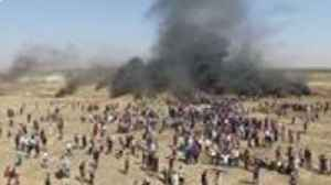News video: Drone Video Shows Burning Tires as Protesters Gather at Gaza Borders