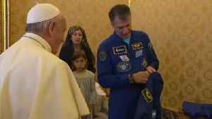 News video: Astronauts Give Pope Personalized Space Suit, Add White Cape