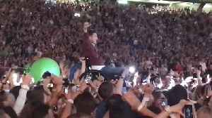 News video: Fan In Wheelchair Crowd Surfs at Coldplay Concert