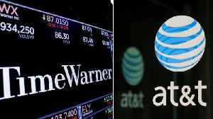 AT&T Merger Approval Causes Time Warner Stock To Jump [Video]