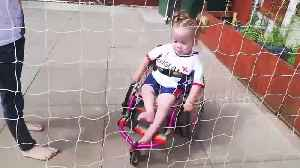Three-year-old girl plays football in her wheelchair [Video]