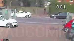 News video: Hero desperately clinging to the bonnet of car
