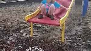 News video: Girl Slides Down And Falls In Mud