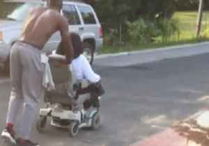 News video: Kind Stranger Pushes Woman Home After Her Electric Wheelchair Breaks Down