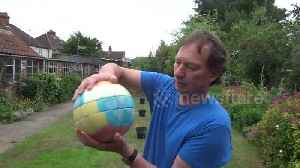 News video: Man makes Rubik's Cube football to mark World Cup