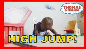 News video: Amazing 1 Yr Old baby Learns how to DUCK For Thomas the Train on Sky High Bridge Jump Set!