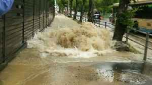 News video: Water Surges Onto Pavement From Burst Pipe Following Japan Earthquake