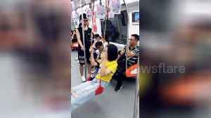 News video: Chinese woman brings own 'swing seat' on train