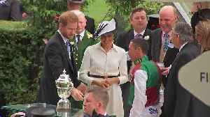 Prince Harry and Meghan hand Ascot trophy to Frankie Dettori