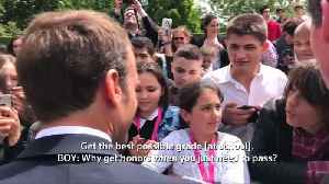Macron tells off red-faced teen heckler: Don't be 'a clown'
