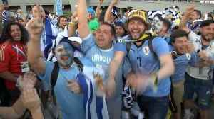 Uruguay fans celebrate victory and qualifying for World Cup knockout stages