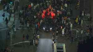 News video: Raw video: Boisterous crowd blocks roadway in Fairfax area during memorial for slain rapper