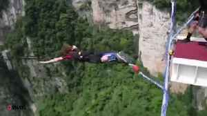 Thrillseeker jumps off world's tallest footbridge