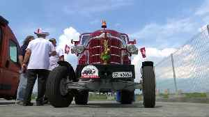 Swiss fans drive tractor to Kaliningrad to support their team