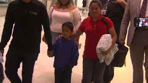 Migrant mother, seven-year-old son reunited after she sues