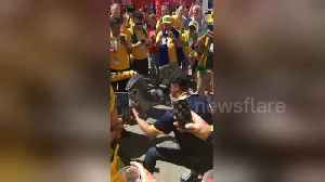 Australian fan performs 'shoey' from moon boot after Australia draw with Denmark