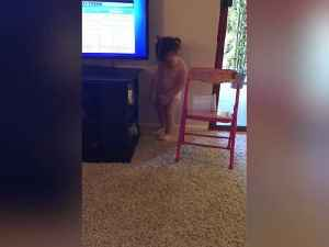 Cute Girl Trying To Fix The TV