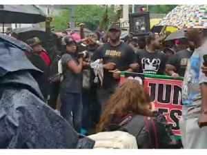 Protesters for Antwon Rose March Through Rain in Pittsburgh's Juneteenth Parade