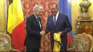 Russian and Belgian foreign ministers exchange soccer T-shirts