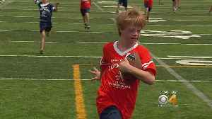 Siblings With Down Syndrome Play Football With Similarly-Abled Peers