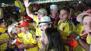 Disappointed Polish fans leave stadium early as Colombian fans rejoice