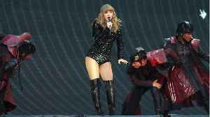 Taylor Swift Performs Surprise Duet With Robbie Williams