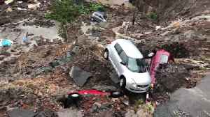 Wall collapses burying several cars following heavy rains in south Mumbai