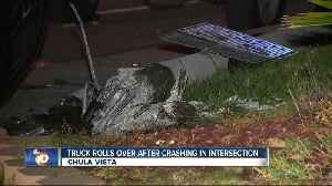 Truck rolls over after crashing at intersection in Chula Vista
