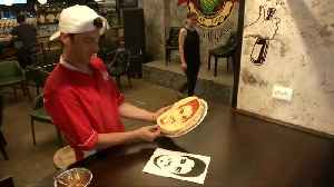 News video: If you can't beat them, eat them - soccer stars Suarez and Ronaldo inspire pizza art
