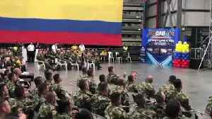 Colombian President Santos Celebrates Round of 16 Qualification With Soldiers [Video]
