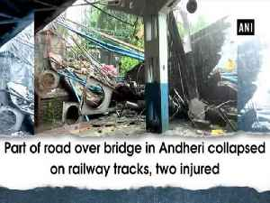 Part of road over bridge in Andheri collapsed on railway tracks, two injured [Video]