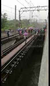 Mumbai commuters clamber out of train and over collapsed bridge [Video]