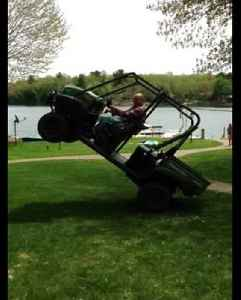 A Man Pulls Over A Tall Antenna With A Tractor And Ends Up Stuck In A Wheelie Position [Video]