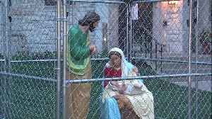 CAGED JESUS USED TO PROTEST ZERO TOLERANCE POLICY [Video]